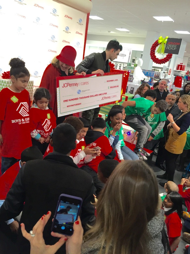 Joe Jonas gives a $100,000 check to the Boys & Girls Club on behalf of JCPenney